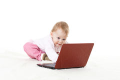 Sweet baby with laptop. Stock Photos