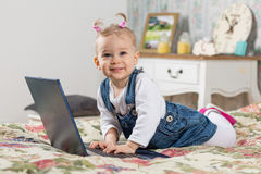 Sweet baby with laptop. Stock Images