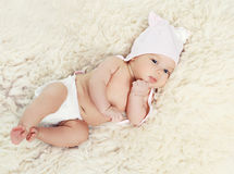 Sweet baby lying on the bed Royalty Free Stock Photography