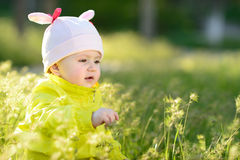 Sweet baby on meadow Stock Photo
