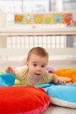 Sweet baby on playmat Royalty Free Stock Photo