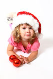 Sweet baby with Santa Claus hat and balls Stock Images