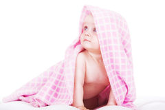 Sweet baby siting under towel Stock Photography