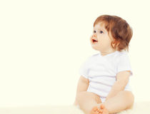 Sweet baby sitting and looking away royalty free stock photos