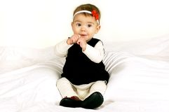 Sweet Baby Sitting Up. Sweet Happy Baby Girl sitting on a white background Royalty Free Stock Photo