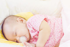 Sweet baby sleeping  on bed at home Royalty Free Stock Photography
