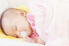 Sweet baby sleeping  on bed at home Royalty Free Stock Images