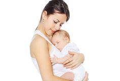 Sweet baby sleeping on hands mother Stock Photography