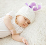 Sweet baby sleeping at home on the bed Stock Image
