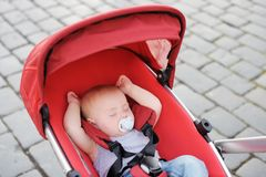 Sweet baby sleeping in stroller Royalty Free Stock Photo