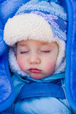 Sweet baby sleeps in a stroller on a walk Royalty Free Stock Photography
