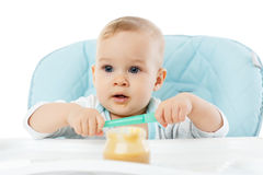 Sweet baby with spoon. Stock Images