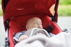 Sweet baby in stroller. Sweet little baby boy sleeping in stroller Royalty Free Stock Photos