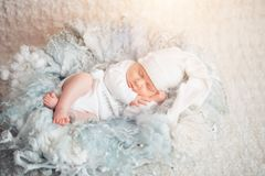 Sweet baby in sweet dream. Newborn two weeks in white clothes sleeping in light blue. the concept of childhood royalty free stock images