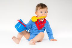 Sweet baby with a toy Royalty Free Stock Image