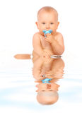 Sweet baby in water. Royalty Free Stock Images