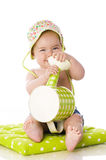 Sweet baby with watering can Stock Photo