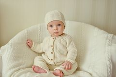 Sweet baby wearing knitted suit Stock Images