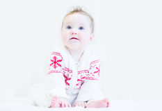 Sweet baby in a white-red winter knitted sweater Stock Photography