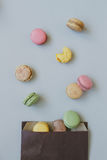 Sweet background. Delicious colorful macaroons on the light blue background, top view Stock Photo