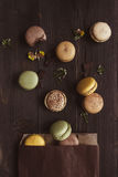 Sweet background. Delicious macaroons on the wooden table, top view Stock Photography