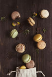 Sweet background. Delicious macaroons on the wooden table, top view Royalty Free Stock Photos