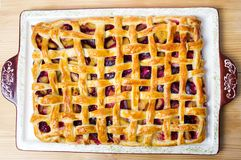Sweet fruit pie with sugar on a tray. Sweet baked fruit pie with sugar on a tray stock photography