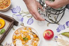 Sweet, baked pumpkin and pie with pear. Autumn dinner for the whole family. Men`s hands in the frame. Copy space.  royalty free stock photo