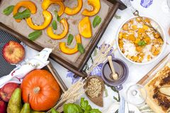 Sweet, baked pumpkin and pie with pear. Autumn dinner for the whole family. Porridge with pumpkin and honey. Copy space, flat lay.  Stock Image