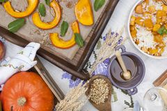 Sweet, baked pumpkin and pie with pear. Autumn dinner for the whole family. Porridge with pumpkin and honey. Copy space, flat lay.  royalty free stock photography