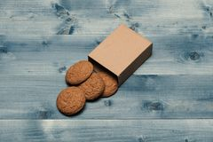 Sweet bakery and delicious snack. Cookies in carton box. On grey wooden background. Nutrition and bakery concept. Oatmeal biscuits as tasty pastry for present Royalty Free Stock Photo