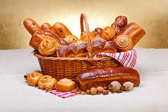 Sweet bakery products in basket Royalty Free Stock Images