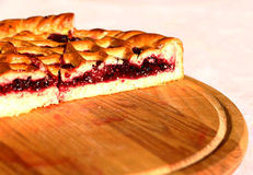 Sweet baking business berry pie on wooden plate Stock Photography