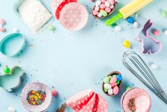 Sweet baking concept for Easter. Cooking background with baking - with a rolling pin, whisk for whipping, cookie cutters, sugar sprinkling, flour. Light blue Royalty Free Stock Photography