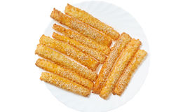 Sweet baking sticks on a white plate Stock Image