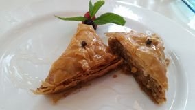 Sweet baklava on plate isolated Stock Photos