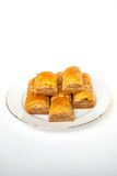 Sweet Baklava on plate isolated on white background. Turkish traditional delight Stock Photo