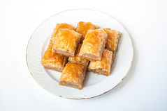 Sweet Baklava on plate  on white background. Stock Photography