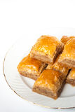 Sweet Baklava on plate  on white background. Royalty Free Stock Photo