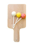 Sweet ball stick on wooden plate isolate, clipping path Royalty Free Stock Photo