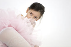 Sweet ballerina girl. Studio portrait of little 7 years old ballerina girl in pink tutu stock images