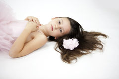 Sweet ballerina girl. Studio portrait of little 7 years old ballerina girl in pink tutu royalty free stock images