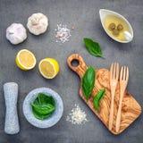 Sweet basil vinaigrette dressing ingredients on dark concrete ba Royalty Free Stock Image