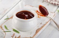 Sweet bbq sauce in a bowl. Selective focus stock photo
