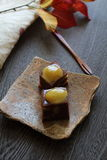 Sweet bean paste with chestnts. Two pieces of jellied bean paste with chestnuts on a plate Stock Photo
