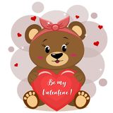 A sweet bear brown in a red bow sits and holds in its paws a red heart with an inscription, in the style of cartoons. A pretty bear brown in a red bow , sitting Stock Images