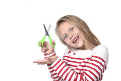Sweet beautiful female child 6 to 8 years old holding cutting scissors school supplies concept Royalty Free Stock Photo