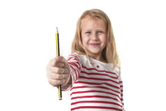 Sweet beautiful female child 6 to 8 years old  holding pencil school supplies concept Royalty Free Stock Images