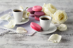 Sweet and beautiful French macaroon in a glass jar and espresso Royalty Free Stock Photos
