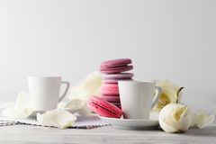 Sweet and beautiful French macaroon in a glass jar and espresso Royalty Free Stock Images